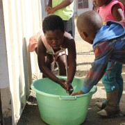 Children washing their hands at Freedom Park before receiving their food (South Africa)