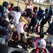 Freedom Park, getting the kids in line for transfer tattoos (South Africa).