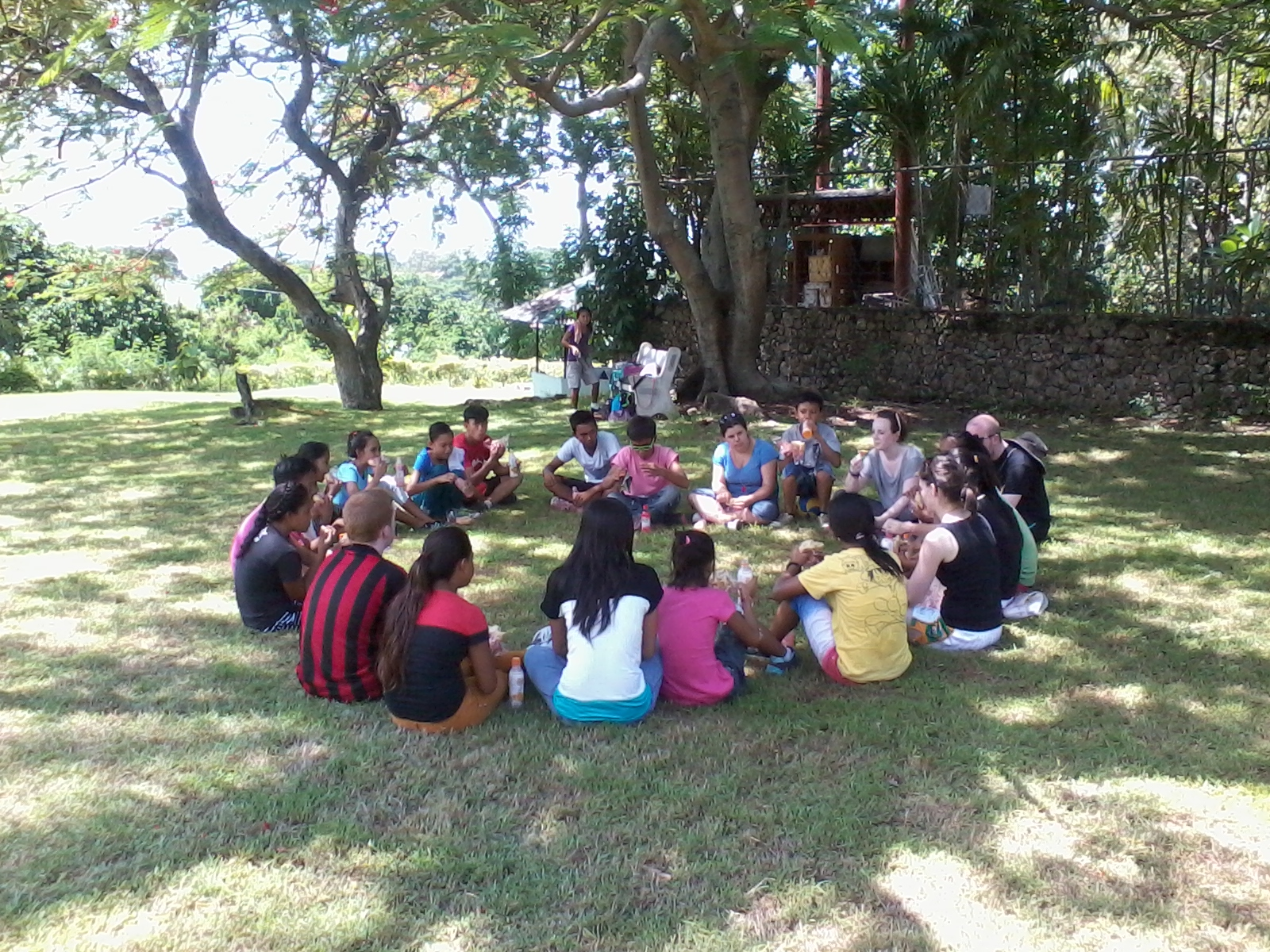 2014 volunteers sharing stories after the sports day in Holy Family Retreat Centre